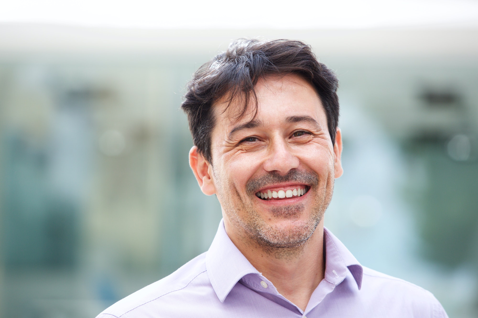 Close up relaxed mature man smiling outdoors
