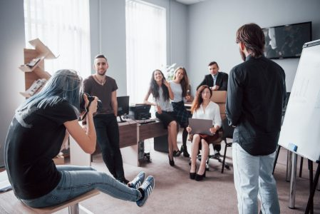 A team of young students in the office are photographed